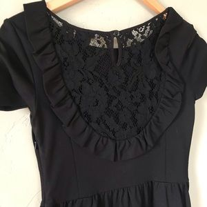 Perfect little black dress with lace cutout back